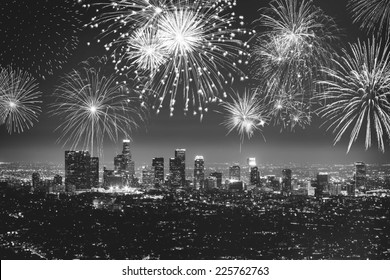 Downtown Los angeles cityscape with flashing fireworks celebrating New Year's Eve in black and white.