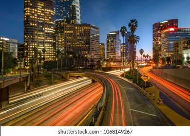 Downtown Los Angeles at night with car traffic light trails