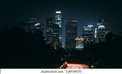 Downtown Los Angeles at night view from highway leading to city