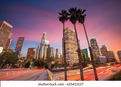 Downtown Los Angeles skyline during rush hour at sunset