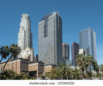 Downtown Los Angeles skyline over blue sky background