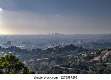 Downtown Los Angeles skyline in smog in California from Griffith Observatory.
