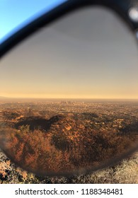 Downtown Los Angeles through sunglasses lense during sunset time near Hollywood sign, Los Angeles California