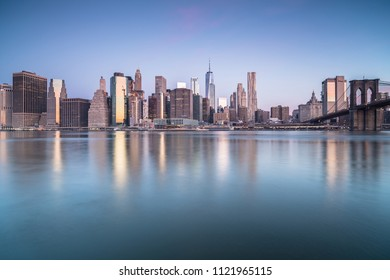 Downtown manhattan with brooklyn bridge view during sunrise