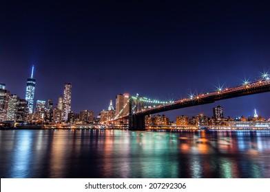 Downtown Manhattan night view from Brooklyn Bridge Park