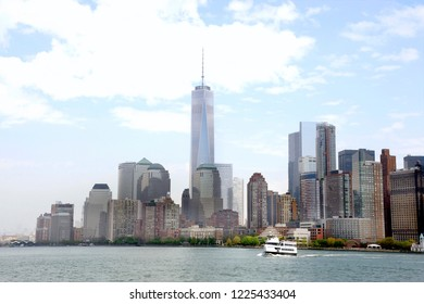 Downtown Manhattan seen from the Staten Island Ferry with the new World Trade Center and at the foreground the ship of the Statue Cruises on the Hudson river in New York, USA