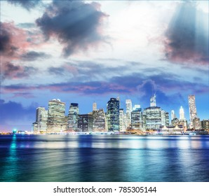 Downtown Manhattan sunset light with river reflections from Brooklyn, New York City.