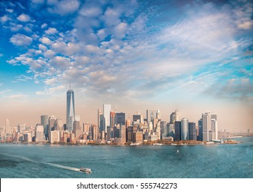 Downtown Manhattan at sunset as seen from Ellis Island, panoramic view.