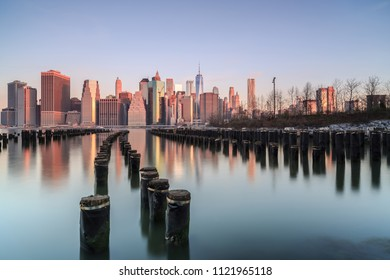 Downtown Manhattan view form broken pier during sunrise