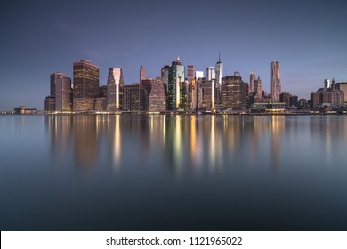 Downtown Manhattan view with water reflection