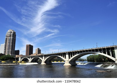 Downtown Minneapolis at left with Central Avenue (Minnesota 65) Bridge over Mississippi River