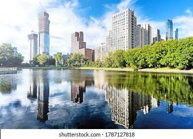 downtown moscow city russia panorama landmark against blue sky background. Modern residential building and park with duck pond urban street landscape view. Summer in city
