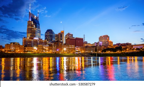 Downtown Nashville, Tennessee city skyline across the Cumberland River (logo's blurred for commercial use)