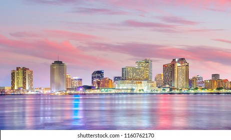 Downtown New Orleans, Louisiana and the Mississippi River at twilight in USA