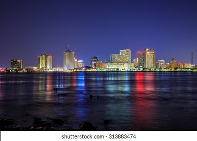 Downtown New Orleans, Louisiana and the Mississippi River at twilight