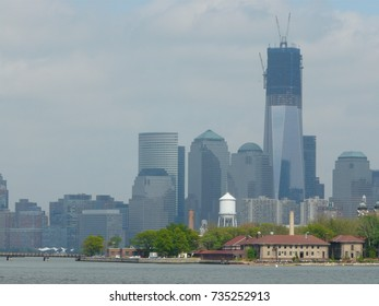 Downtown NYC viewed from the other side on a spring day while building the new tower