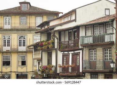 The downtown ot the medieval city of Guimaraes. Old houses in Oliveira Square, next to the church. Portugal