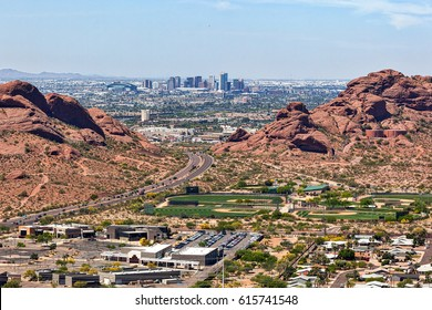 Downtown Phoenix, Arizona aerial view from Scottsdale framed between the Papago Buttes
