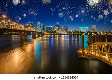 Downtown Portland celebrating New Years Eve with colorful fireworks in the sky above Wilamette river, in Oregon, USA