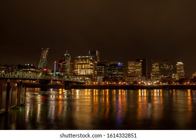 Downtown Portland viewed from the Eastbank Esplanade. The Hawthorne Bridge  is visible on the left side.