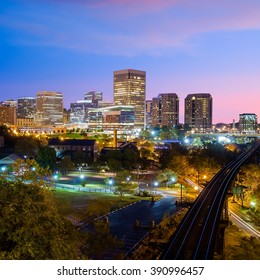 Downtown Richmond, Virginia skyline and the James River at twilight.