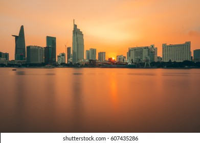 Downtown Saigon, Ho Chi Minh city in yellow sunset - the biggest city in Vietnam