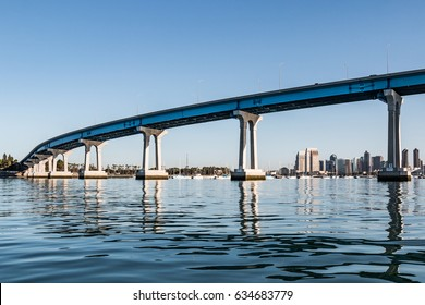 Downtown San Diego skyline in background with Coronado Bridge in the foreground.