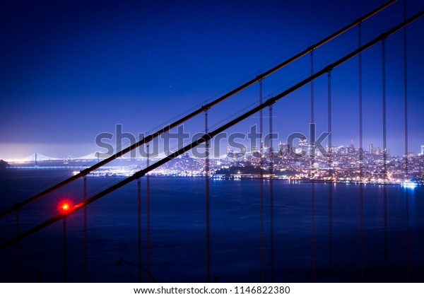 Downtown San Francisco, Golden Gate Bridge and Bay Bridge at night. View from Battery Spencer.