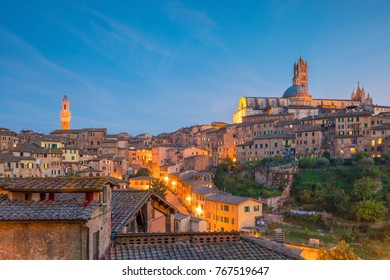 Downtown Siena skyline in Italy at twilight