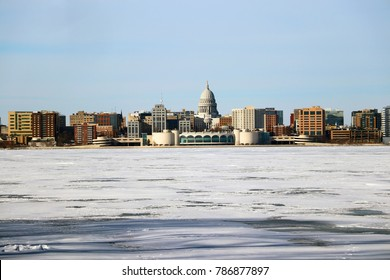 Downtown skyline city of Madison with State Capitol building. Madison winter cityscape with frozen lake Monona on a foreground during cold sunny day. Midwest USA, Wisconsin.