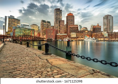 Downtown skyline city view of Boston Massachusetts USA looking over the riverfront harbor and marina boat dock from Fan Pier Park