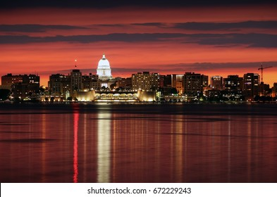 Downtown skyline of Madison, the capital city of Wisconsin, USA.After sunset view with State Capitol building dome against beautiful bright sky and reflection in lake water as seen across lake Monona.