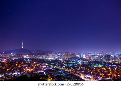 Downtown skyline of Seoul, South Korea with Seoul Tower and star