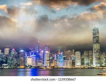 Downtown skyscrapers with city lights at night from Kowloon. Hong Kong, China.