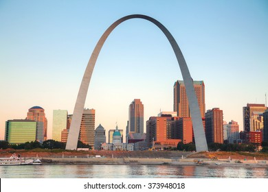 Downtown St Louis, MO with the Old Courthouse and the Gateway Arch at sunrise