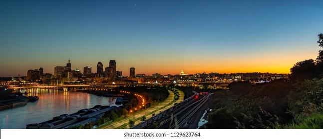 Downtown St. Paul Minnesota sunset cityscape landscape skyline. Light trails, state capital, skyscrapers, mississippi river, railroad
