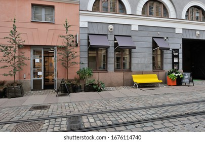 Downtown Street of Helsinki with Tram Rail, Wooden Bench and Stores in Finland in August 2019