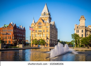 Downtown Syracuse New York with view of historic buildings and fountain at Clinton Square.