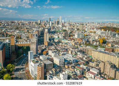 Downtown Tokyo skyline in Japan with blue sky