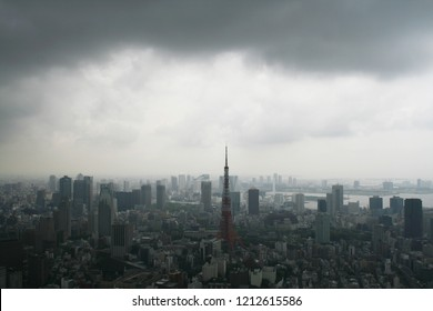 Downtown Tokyo skyline seen from Roppongi Hills before a storm.