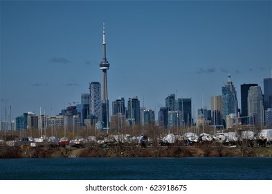 Downtown Toronto on April 17, 2017.  The view of financial towers of Toronto, Ontario from  Tommy Thompson Conservation Area in the east side of the city, favorite place of city outdoor enthusiast.