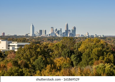 Downtown uptown Charlotte, North Carolina skyline in the distance beyond vibrant fall colored trees
