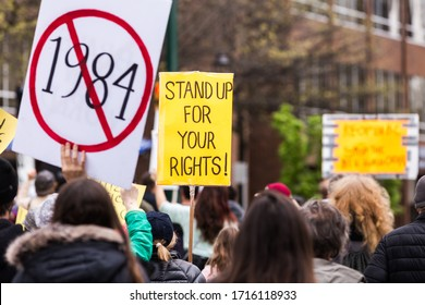 DOWNTOWN VANCOUVER, BC, CANADA - APR 26, 2020: Anti lockdown protesters march in defiance of the government imposed quarantine measures taken to slow the spread of the Covid 19 virus.