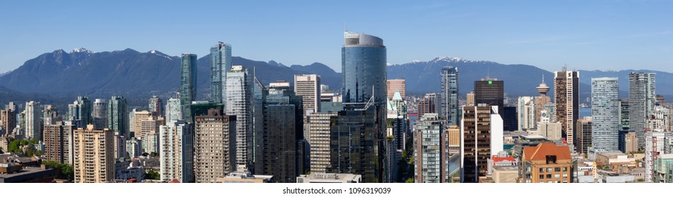 Downtown Vancouver, British Columbia, Canada - May 14, 2018: Aerial view of the modern city skyline during a sunny day.