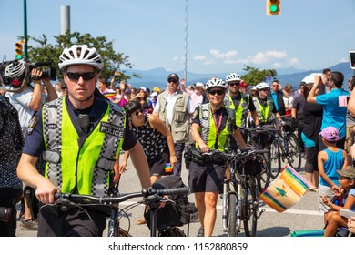Downtown Vancouver, British Columbia, Canada - August 5, 2018: Vancouver Police, security and body guards are protecting the Canadian Prime Minister, Justin Trudeau, at the Gay Pride Parade.