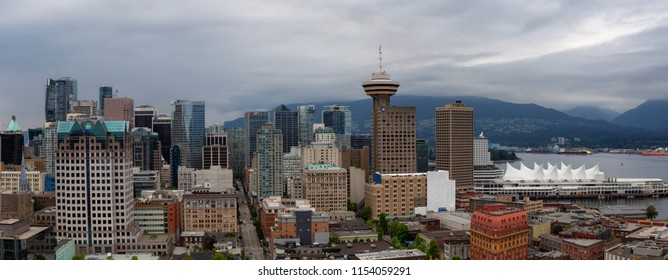 Downtown Vancouver, British Columbia, Canada - June 22, 2018: Aerial panoramic view of the modern City Skyline during a cloudy summer evening.