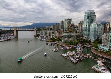 Downtown Vancouver, British Columbia, Canada - June 14, 2018: Aerial view of False Creek during a vibrant summer sunset.