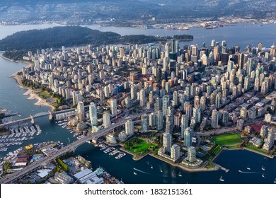 Downtown Vancouver City, British Columbia, Canada. Beautiful Aerial View from Above of a Modern Cityscape. Colorful Vibrant Sunset. Urban Buildings, Bridges and Streets.
