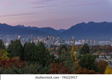 Downtown Vancouver city and mountains view from Queen Elizabeth Park at early night