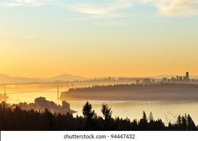 Downtown Vancouver and Lions Gate Bridge at winter sunrise, viewed from Cypress Mountain lookout